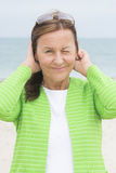 Friendly woman with twinkle face expression Stock Images