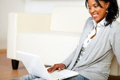 Friendly woman using her laptop Royalty Free Stock Image