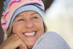 Friendly Woman with warm beanie hat in winter outdoor Royalty Free Stock Photos