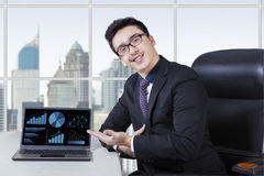 Friendly worker with growing business chart Stock Image