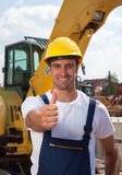 Friendly worker with his bulldozer showing thumb Royalty Free Stock Photos
