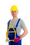Friendly worker with yardstick- house. Worker with yardstick- house in front of white background Royalty Free Stock Images