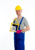 Friendly worker with yardstick and pocket calculator Royalty Free Stock Photos