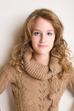 Friendly young blond. Portait of a friendly young blond in brown sweater Stock Image