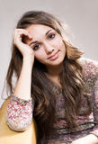 Friendly young brunette teen. Stock Photography