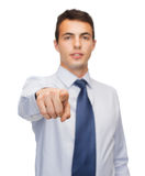 Friendly young buisnessman pointing finger Royalty Free Stock Photography