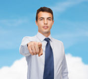 Friendly young buisnessman pointing finger Stock Image
