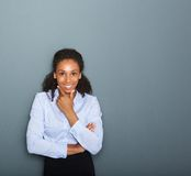 Friendly young business woman thinking Royalty Free Stock Images
