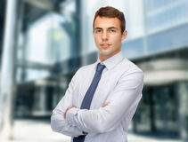 Friendly young businessman Stock Images