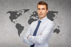 Friendly young businessman with crossed arms Royalty Free Stock Photos