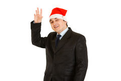 Friendly young businessman in hat of Santa Claus Stock Photo