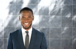 Friendly young businessman smiling Stock Photos