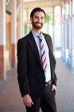 Friendly young businessman smiling outside Stock Photo