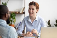 Friendly company executive interviewing candidate for vacancy royalty free stock photography