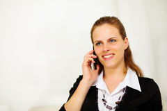 Friendly young businesswoman on mobile phone Royalty Free Stock Photography