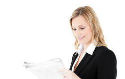 Friendly young businesswoman reading newspaper Royalty Free Stock Image