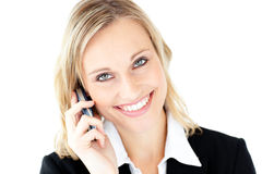 Friendly young businesswoman talking on phone Stock Image
