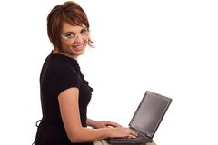 Friendly young Caucasian female working on laptop Royalty Free Stock Image