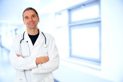 Friendly young doctor with crossed arms Stock Photos