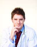 Friendly young doctor looking at the camera Stock Images