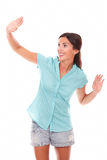 Friendly young female gesturing a greeting Royalty Free Stock Photo