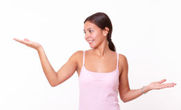 Friendly young female holding her hands up Stock Photos