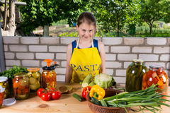 Friendly young girl bottling vegetables Royalty Free Stock Photography