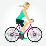 Friendly young girl riding bicycle happy Royalty Free Stock Photos