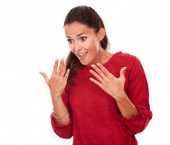 Friendly young lady with surprised gesture Stock Photography
