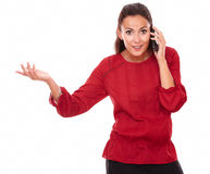 Friendly young lady talking on her phone Stock Photos