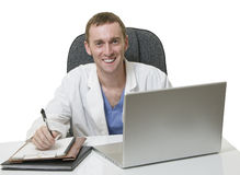 Friendly young male Doctor sitting in the office Stock Photography