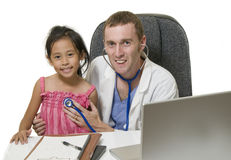 Friendly young male Doctor with young child Royalty Free Stock Photography