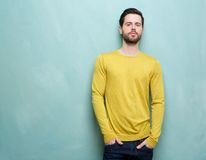 Friendly young man posing in yellow shirt Royalty Free Stock Photo