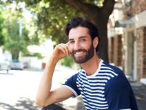 Friendly young man smiling outdoors Royalty Free Stock Images