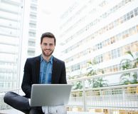 Friendly young man using laptop Stock Images