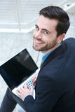 Friendly young man working on laptop Stock Photography