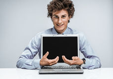 Friendly young manager shows equal balance of interest Stock Photo