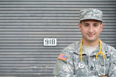 Friendly young military doctor in uniform stock photos