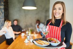 Free Friendly Young Waitress With Appetizers Stock Photography - 159420602