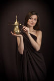 Friendly young woman with the arabic teapot Royalty Free Stock Photography