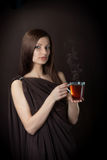 Friendly young woman with the cup of tea Stock Photography