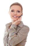 Friendly young woman helpline operator in headset Royalty Free Stock Photo