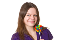 Friendly young woman with lollipop Royalty Free Stock Photography