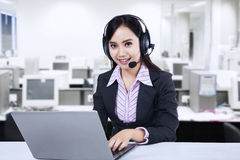 Friendly young woman operator Royalty Free Stock Images