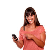 Friendly young woman pointing her cellphone Stock Photos