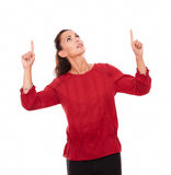 Friendly young woman pointing up her fingers Stock Photos