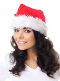 Friendly young woman in a red santa hat Stock Images
