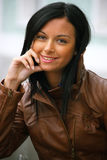 Friendly young woman smiles. Friendly a young woman smiles Royalty Free Stock Photo