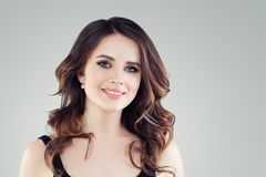 Friendly young woman smiling. Young female face on white background.  royalty free stock photo