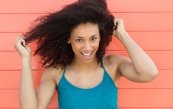 Friendly young woman smiling outdoors Royalty Free Stock Images